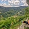 Woman sitting on a bench enjoying the views of Wachau valley