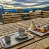 Coffee and cake with view to Schneeberg Viennese Alps