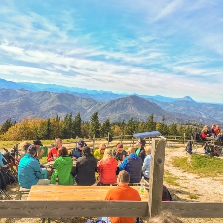 Austrian Alps hikers enjoy the sun and the view on the mountain range