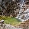Ötschergräben Grand Canyon of Austria hiker takes a break at the Mirafall waterfall