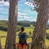 Hafnerberg woman sitting on bench overlooking the landscape