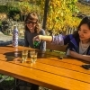 Two girls taking a break and trying some Grüner Veltliner wine on the Wachau World Heritage Trail